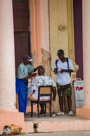 """AMAZING barber shop in Havana city. I love this shoot!!!"""
