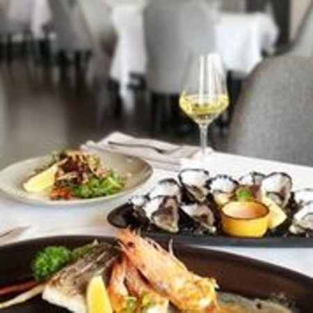 Natural Oysters, Barramundi and King Prawn