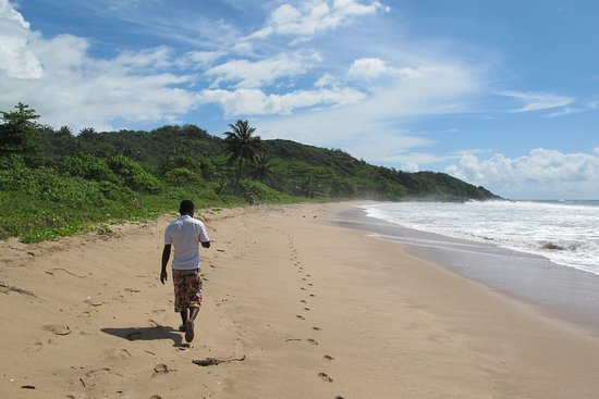 I hike with my Local Guide William Quayson from Busua to Butre. We walk one hour to Butre.  William leads Trips to Butre and Dixcove.