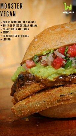 Monster vegan: 2 breaded and fried zuchini steak, chilli vegan, guacamole, sliced tomato, onion and cilantro, ciabbata bread.