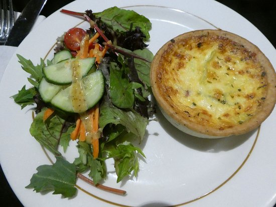 a quiche with side salad