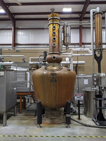 The Bear is a hybrid still, part column still and part pot still. Note the gin basket for holding botanicals in gin production.