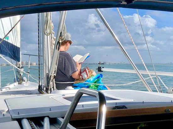 My wife enjoying one of her all-time favorite activities, reading while the expanse of the Gulf of Mexico is the view just over the top of her book.