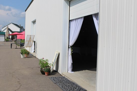 Overhead doors to Rustic Barn Building lead out to patios and the fairway of the three holes of regular golf, a Par 3,4 & 5 course with stadium lights!
