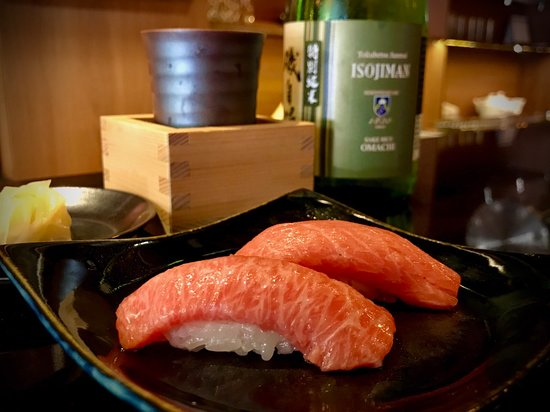 "Chu-toro and o-toro from a 250 kgs. Northern Atlantic Bluefin Tuna caught off the coast of Gijon, Spain. Served with Isojiman ""Omachi"" Junmai Genshu from Shizuoka Prefecture. For sushi lovers, it doesn't get any better than this!"