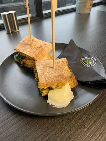 Treforest, UK: Poached egg,hash Brown,kale and vegan cheese on ciabatta