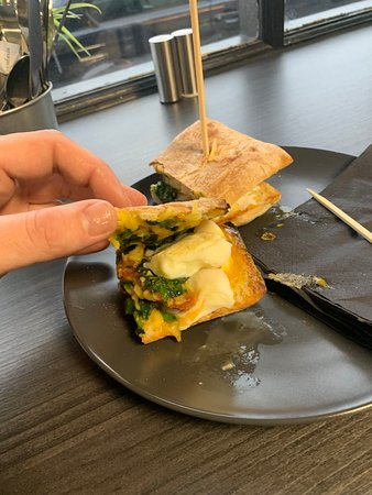 Treforest, UK: The inside of the poached egg hash brown kale and vegan cheese ciabatta