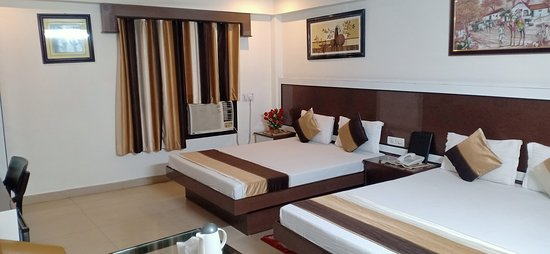 Family Deluxe Ac has a well appointed living area, a comfortable bedroom with a warm and cozy double bed It also has a spacious and spotlessly clean toilet with running hot and cold water. Super Deluxe Room Offer Basic Amenities like :- Air conditioning,Minibar,Telephone, Hair dryer, Internet access, Private bathroom,Color television, Refrigerator,Newspaper,24 hours hot and cold water etc.