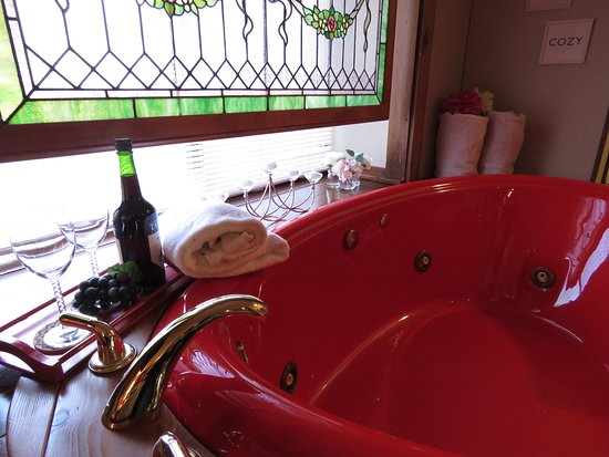 Heart-shaped 2 person jetted tub. Just add a bottle of bubbly, swing the TV around the relax.