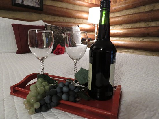 Luxury bed linens in an authentic log lodge from 1947. Add any of our packages to make it special.