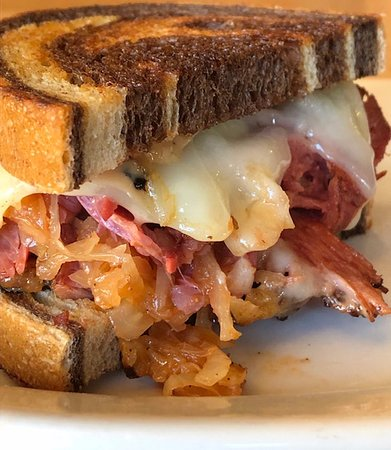 Grindstone Reuben on Rye with House-made Kraut, 1000 Island, Swiss & Fries, we've been told it beats out any you'll find in NYC!