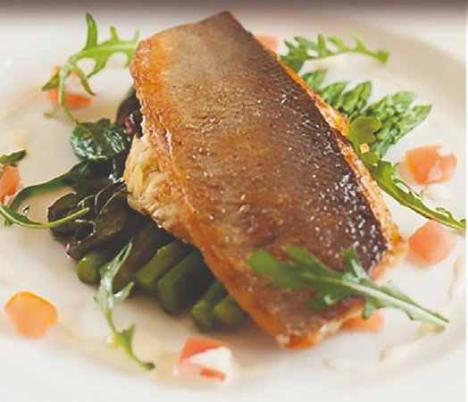 Absolutely delicious  sea bass on a bed of asparagus