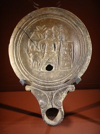 Aeneas flees the burning Troy.. A Roman lamp from the 1st century AD