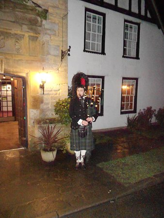 Scottish Piper Playing The Bagpipes on New Years Eve