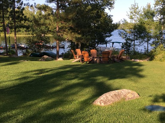 One of several fire pit areas at River Point Resort & Outfitting Co. with complimentary firewood.