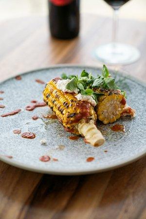 Charred corn with bravas sauce
