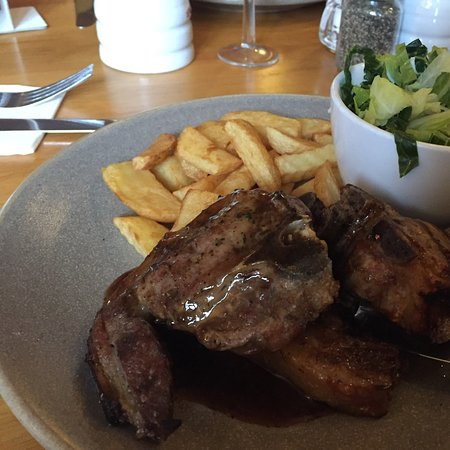 Thorne, UK: 3 large lamb chops with mash or home made chips, veg or mushy peas and mint gravy. Absolutely delicious at £14. As a group of three, we all opted for these chops. An old pub, extremely friendly staff.