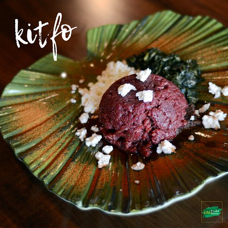Come and try our KITFO today! Prime beef tartare seasoned with Ethiopian clarified butter, Ethiopian chili powder and accompanied by (Ayeb) crumbled cottage cheese & collard greens. Can be served raw for the adventurists, lightly sautéed for the kind of bold or cooked well.