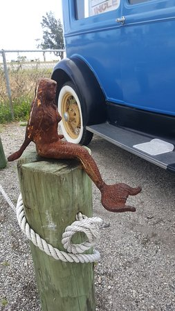 cast iron mermaid and old car for sale