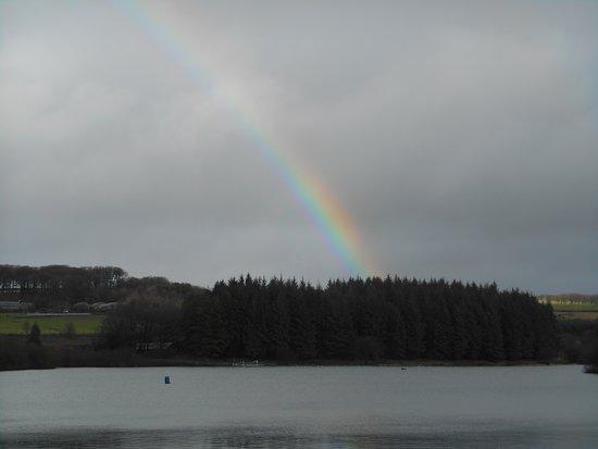 Kentisbury, UK: Rainbow over the reservoir (yes, it did rain - just a little!)