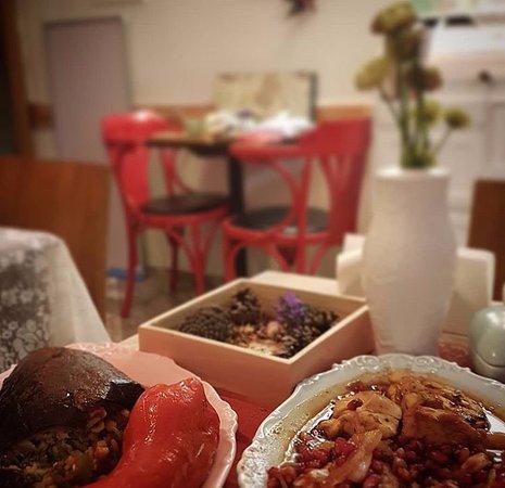 Stuffed Aubergine (Eggplant Dolma) And Joojeh Anari (Chicken Stu Cooked With Pomegranate And Pomegranate Sauce)
