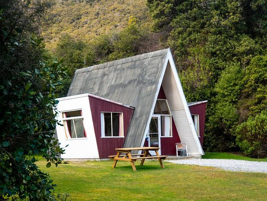 The property has a shared communal lodge with a kitchen, bathroom facilities, a cozy fire for the colder months.