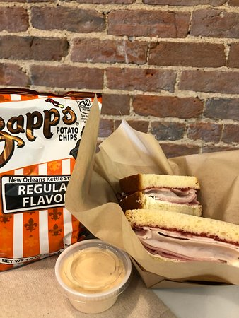 Sandwiches come with chips and famous Adams chip dip.