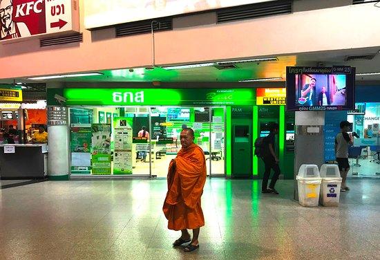 a mank in orange - Chatuchak Bus Terminal - Bangkok