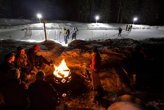 In winter, our pond turns into an outdoor rink for skating and hockey. A firepit and chopped wood are beside it, perfect for warming up after a skate.