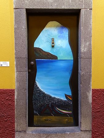 Funchal is a very nice town with lots of restaurants and narrow cobblestone streets. The streetart is everywhere on doors and houses. Very beautiful. We stayed in Funchal during our holidays.