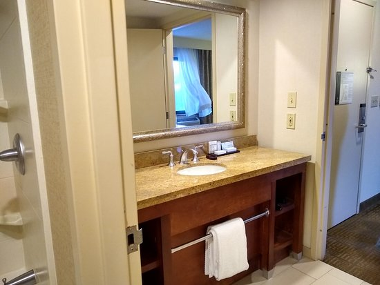 Sink Vanity Area Connects The Sitting Area And Bedroom Picture Of Embassy Suites By Hilton Portland Maine Tripadvisor