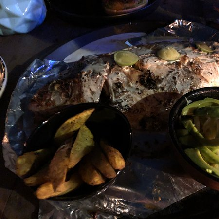 Fresh seafood by candlelight on the beach