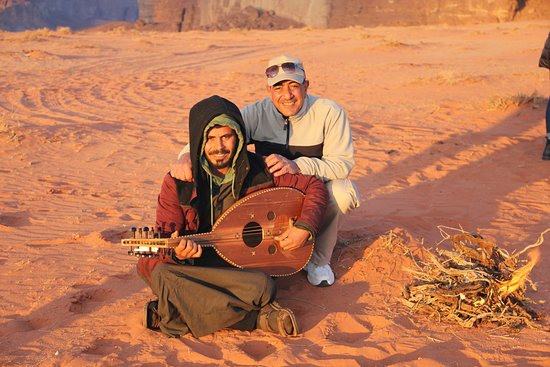 Our driver playing his oud along with our tour guide, Kareem.