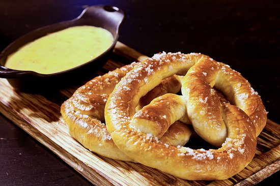 Honor: Queso Dip and Pretzels Two soft baked pretzels with queso dip.