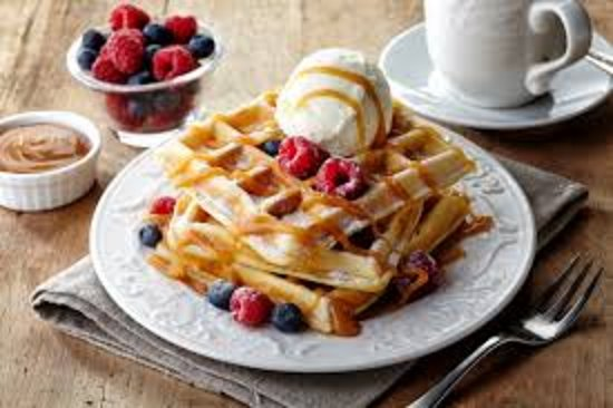 Freshly made waffled, topped with ice cream