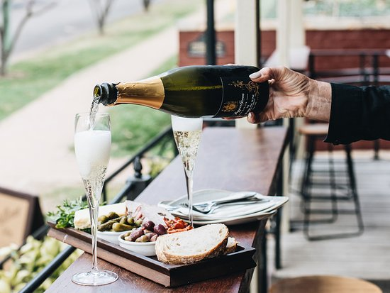 PepperGreen Estate outdoor dining with Sparkling wine and tasting board