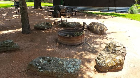 Kerens, TX: Fire pit. Split wood provided.