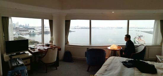 corner room double bed overlooking day view of  yamashita park and sea. the night view from second window is of minato mirai