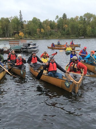 What a cool paddling time was had by all as seven canoes leave River Point's docks.