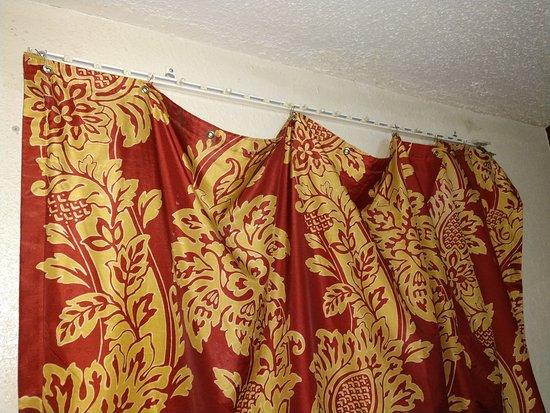 Curtain falling off