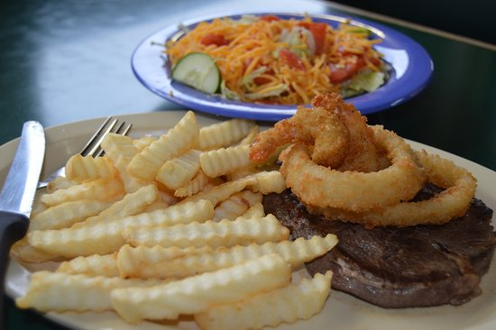 Gate City, VA: Hamburger Steak, topped with onion rings, with a side of French fries and fresh salad.