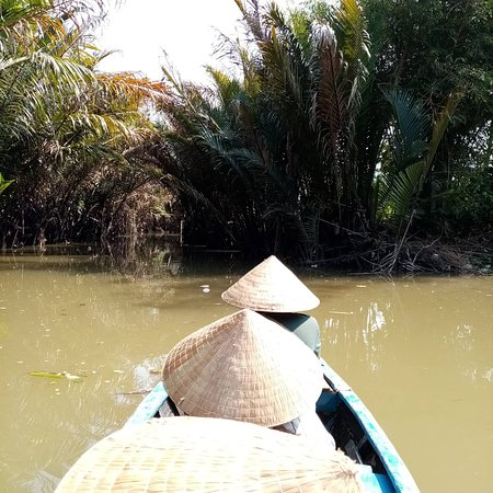 Mekong delta tour. they will lend you a traditional Vietnamese hat