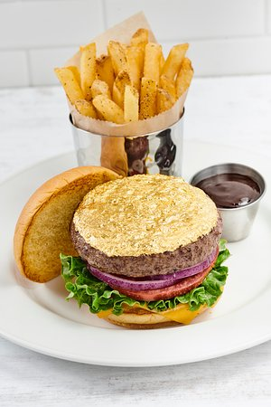 24-KARAT GOLD LEAF STEAK BURGER™ - Steak burger, topped with 24-karat edible gold leaf, served with cheddar cheese, leaf lettuce, vine-ripened tomato and red onion. It's pure gold only for true rockstars!