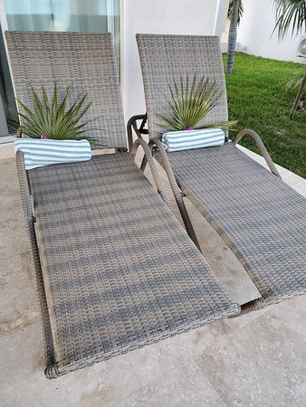 The lounge chairs were decorated with palm fronds and flowers