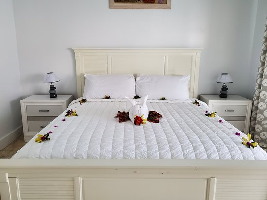Bed decorated with flowers and leaves
