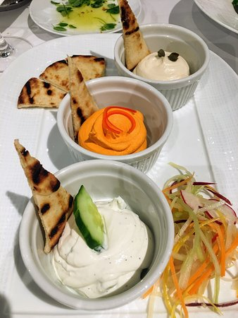 Greek Meze Platter with warm pita and marinated raw vegetables.