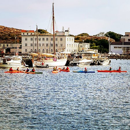 Outdoor West Sweden: Kayaks are launched in the Northern harbour, next to the quaint old town of Lysekil. Sheltered by two islets the water is almost always calm here. An the sunsets are incredible. 