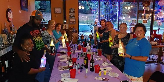 Recycled wine bottles are turned into nice lamps in our Wine Therapy events.