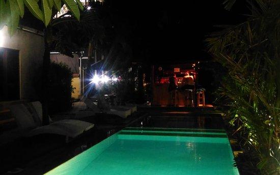 Swimming pool with pool bar, night time