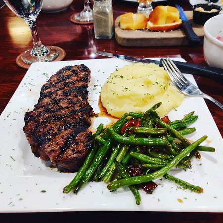 KC Strip 12oz with whipped mashed potatoes and bourbon green beans.